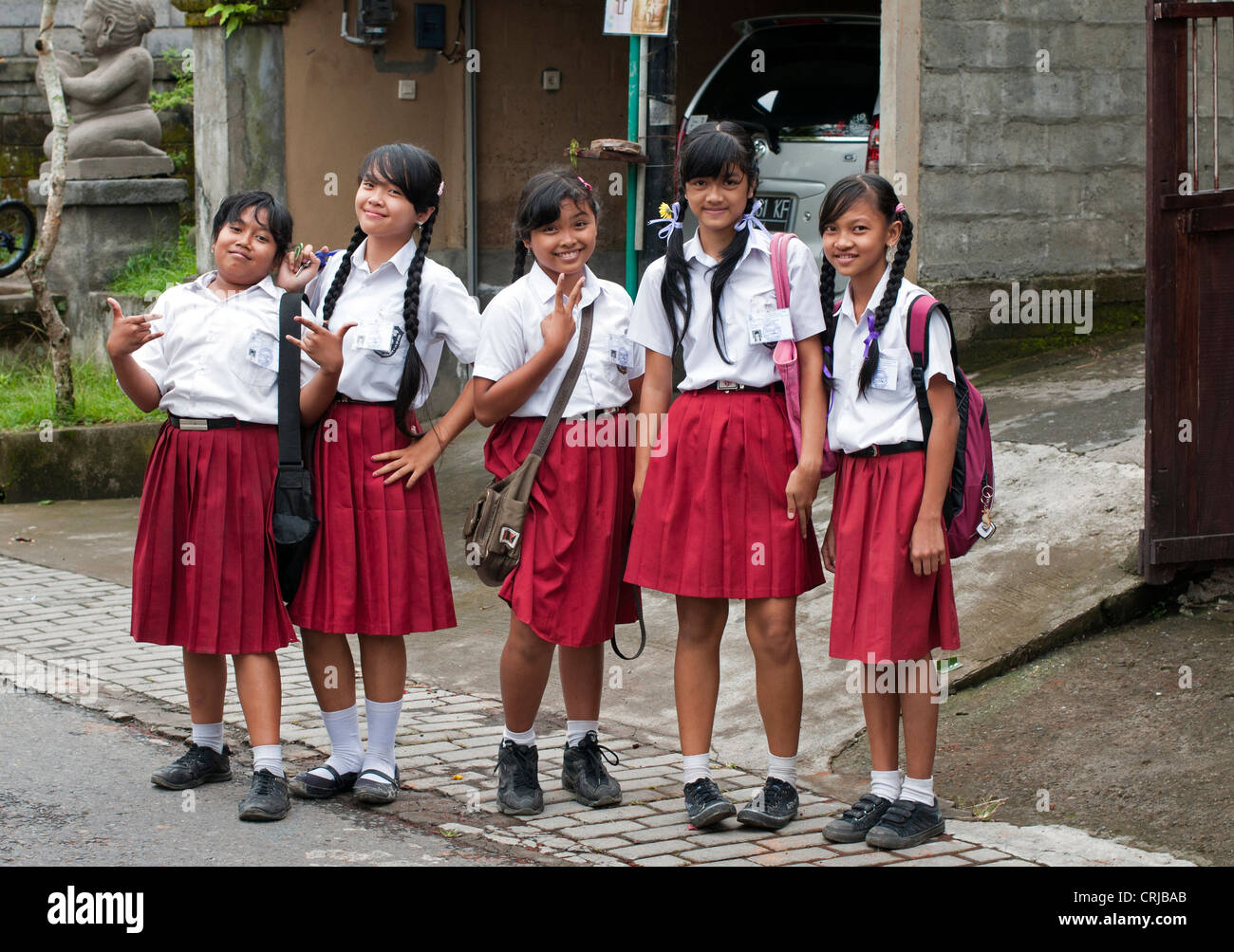 Ubud 5 April 2011 Young School Girls In Uniform On The Stret