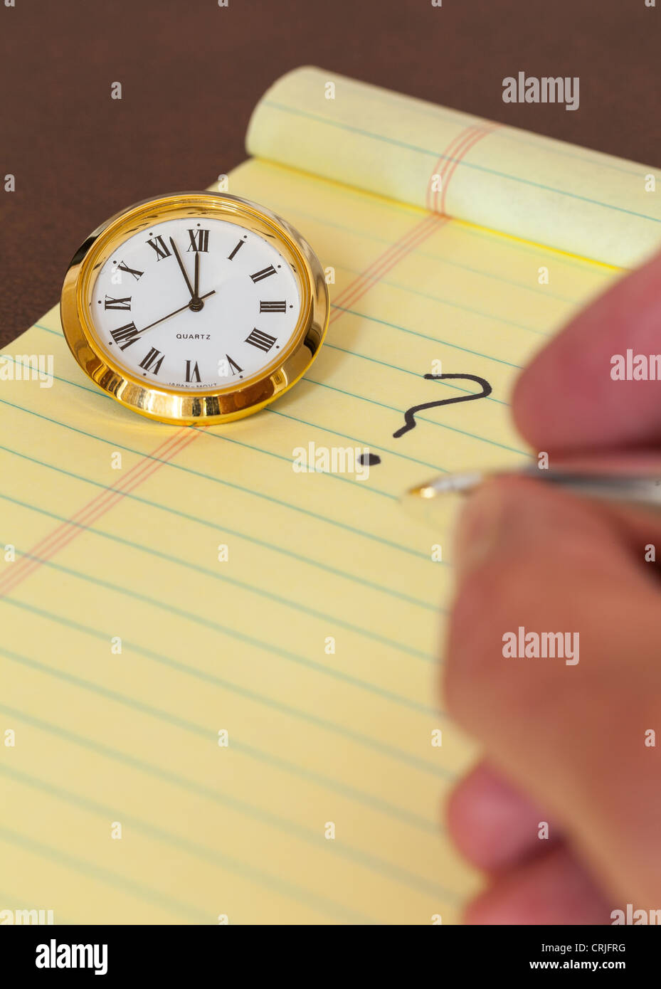 Concept for urgent decision making with clock on paper and question mark on pad - Stock Image