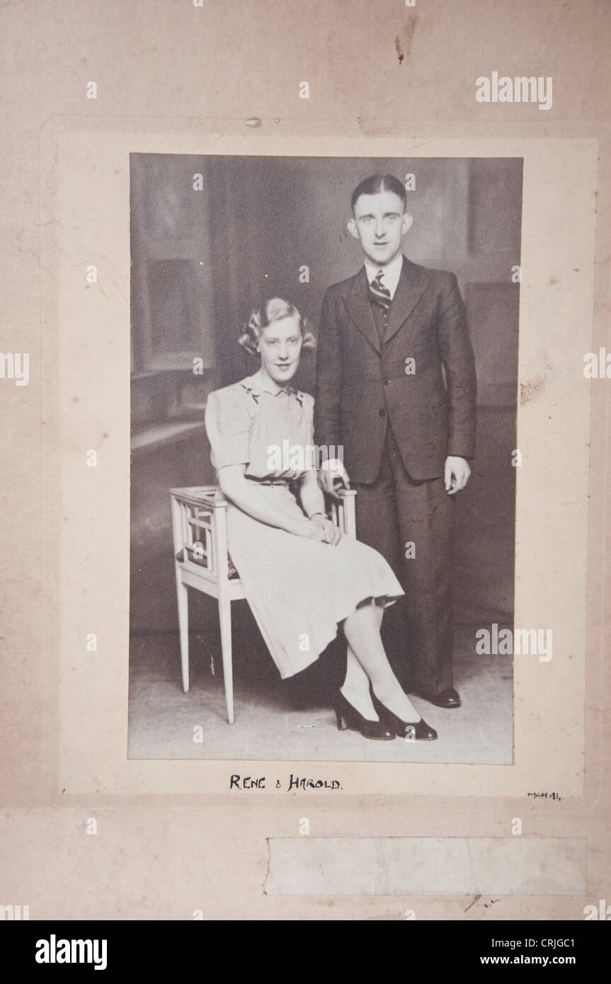 Old photograph of 1930s couple in mount - Stock Image