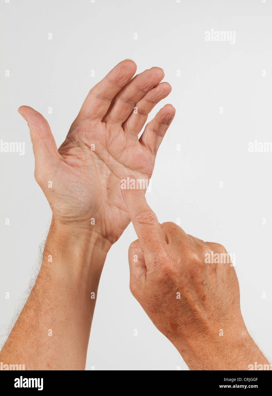 Concept showing an empty hand as if it was holding a phone and pressing keys on screen of smartphone - Stock Image