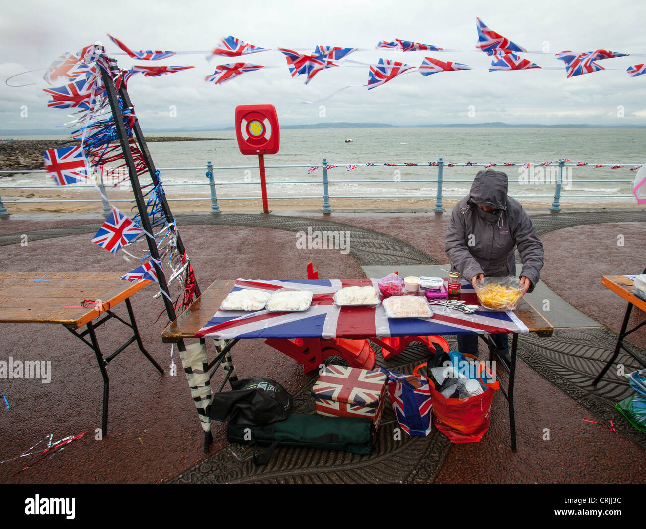 Stormy weather at the world's largest street party to celebrate the Queen's Diamond Jubilee in Morecambe, - Stock Image