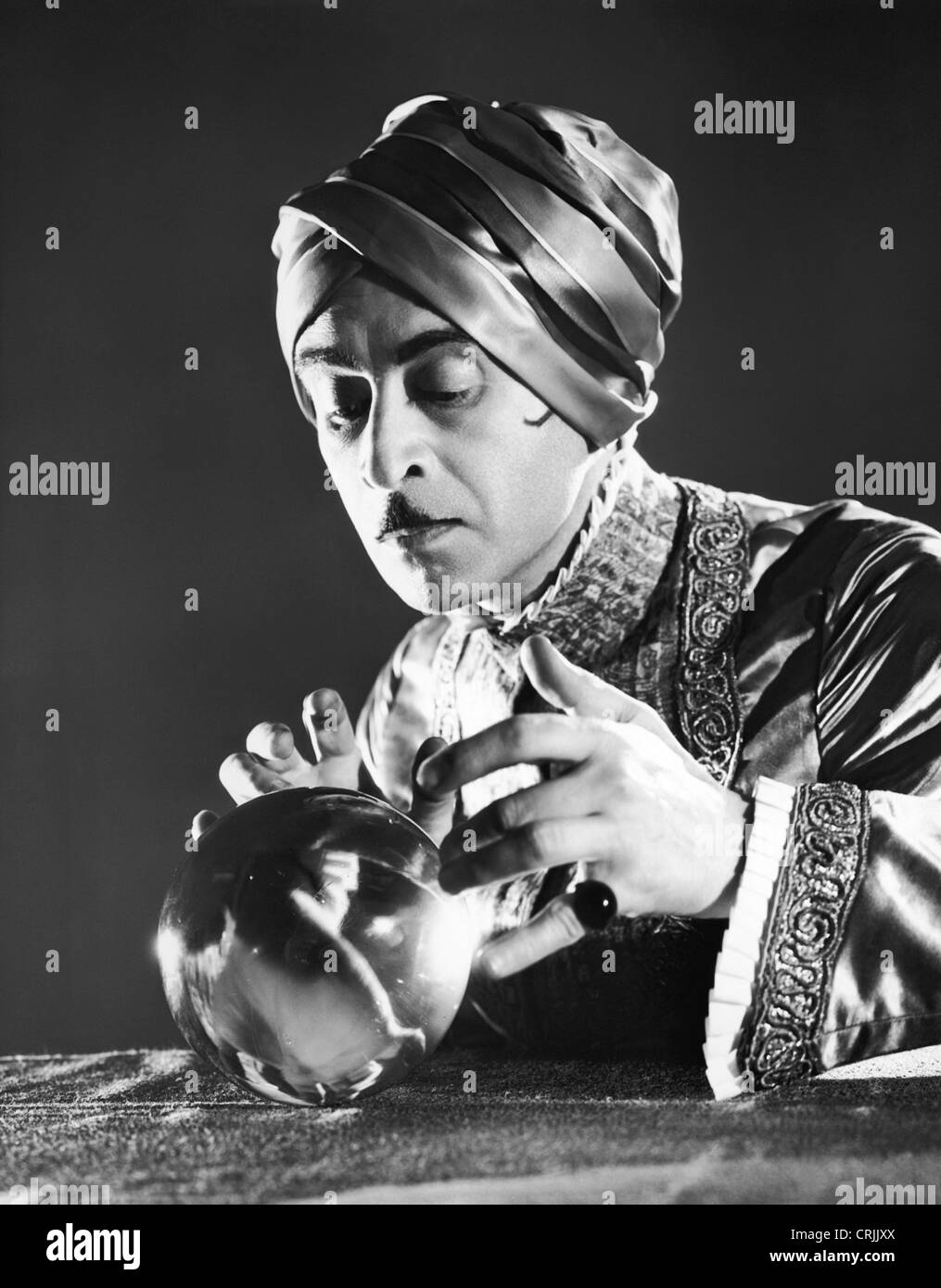 Fortune teller and crystal ball - Stock Image