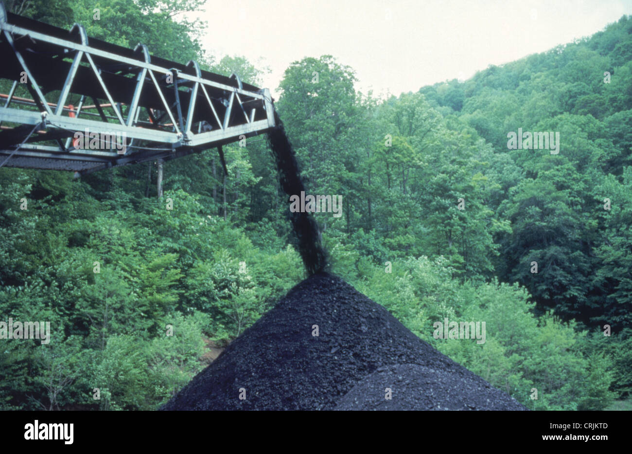 Coal mining conveyor belt and coal pile in West Virginia - Stock Image