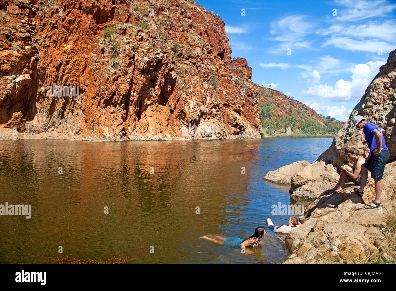 Cooling off in Glen Helen Gorge in the West MacDonnell Ranges - Stock Image