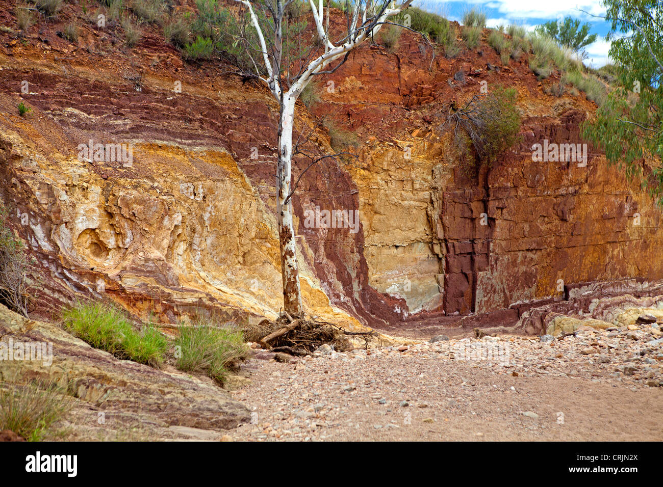 The coloured walls of the Ochre Pits in the West MacDonnell Ranges - Stock Image