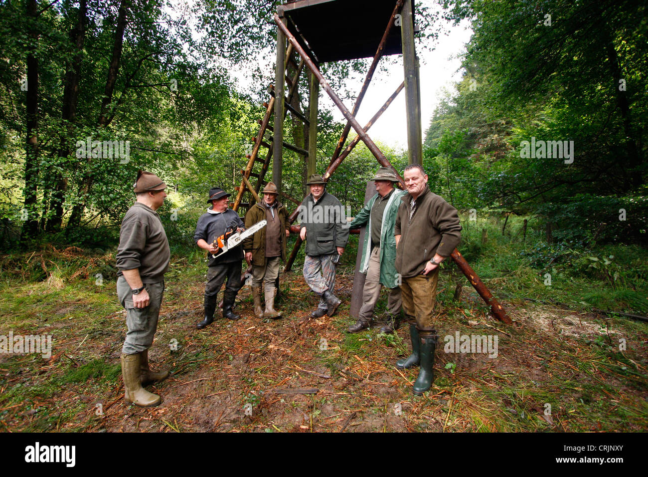 constructing a raised hide - group photo after finishing the substructure, Germany - Stock Image