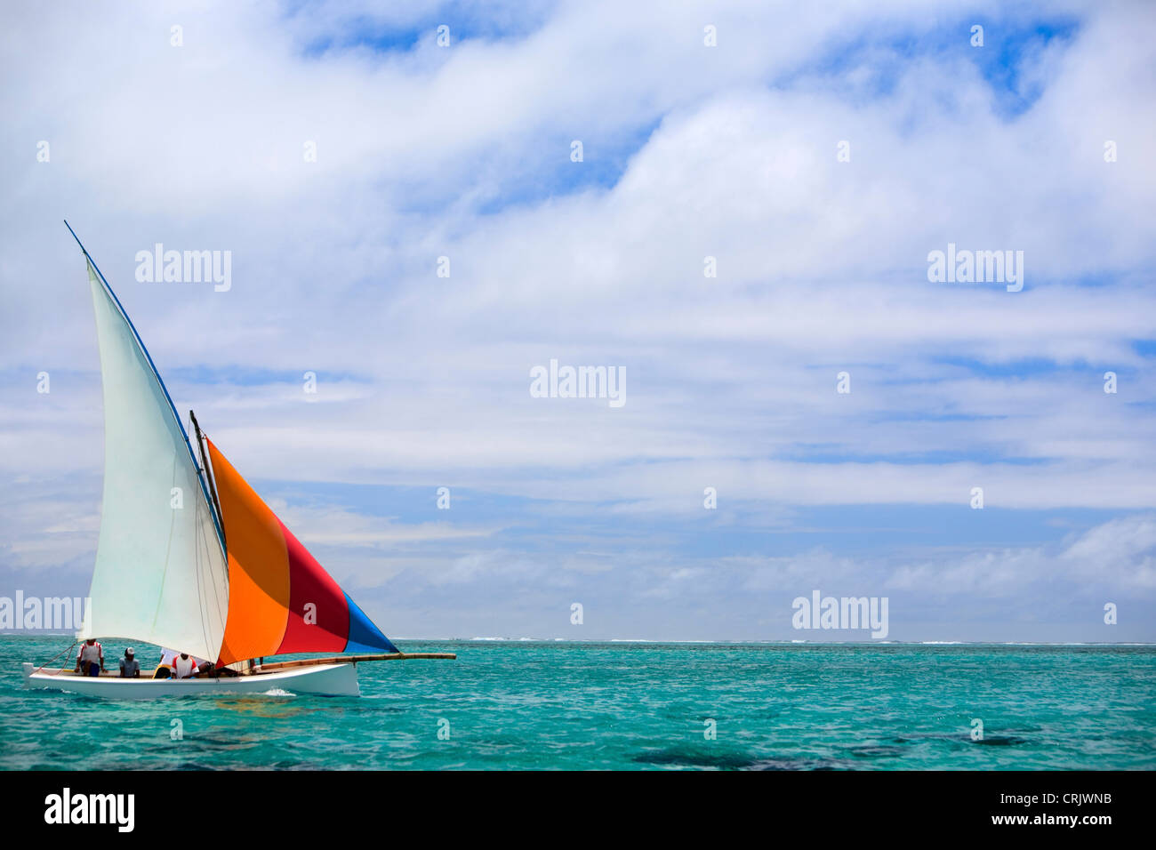 Mauritian wooden boat called Pirogue during a regatta, Mauritius, Indian Ocean - Stock Image