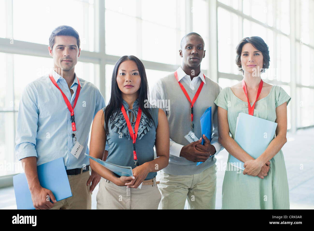 Business people wearing name tags - Stock Image