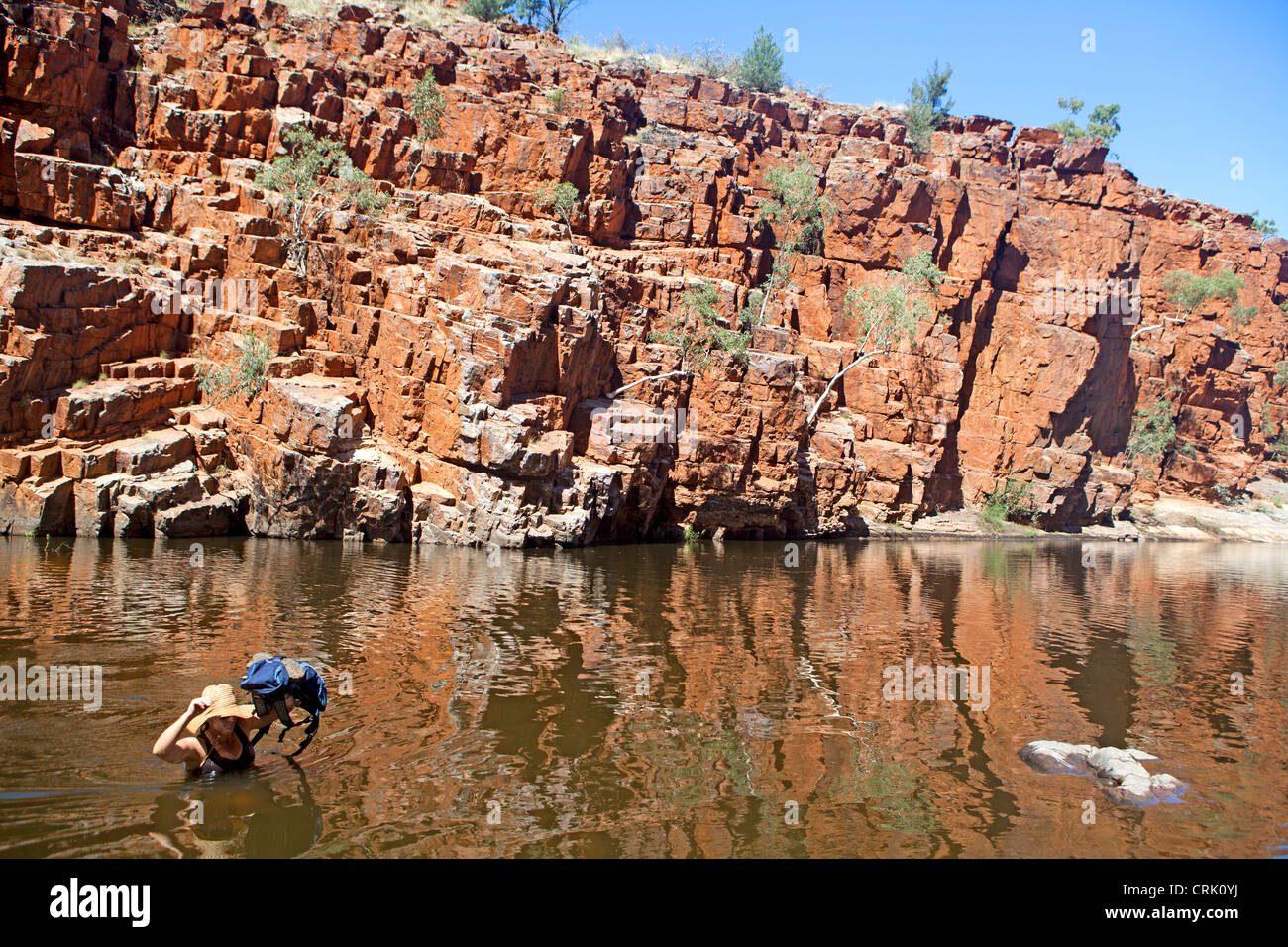 Fording a waterhole in Ormiston Gorge in the West MacDonnell Ranges - Stock Image