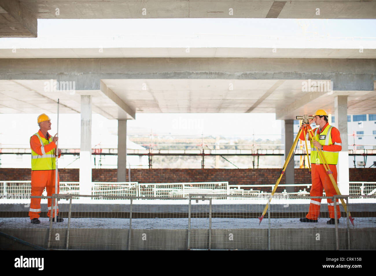 Workers using equipment on site - Stock Image