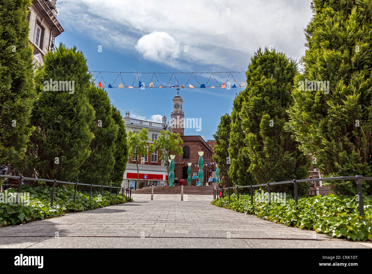 Warrington Town Centre with water feature and The Church of the Holy Trinity, Warrington - Stock Image