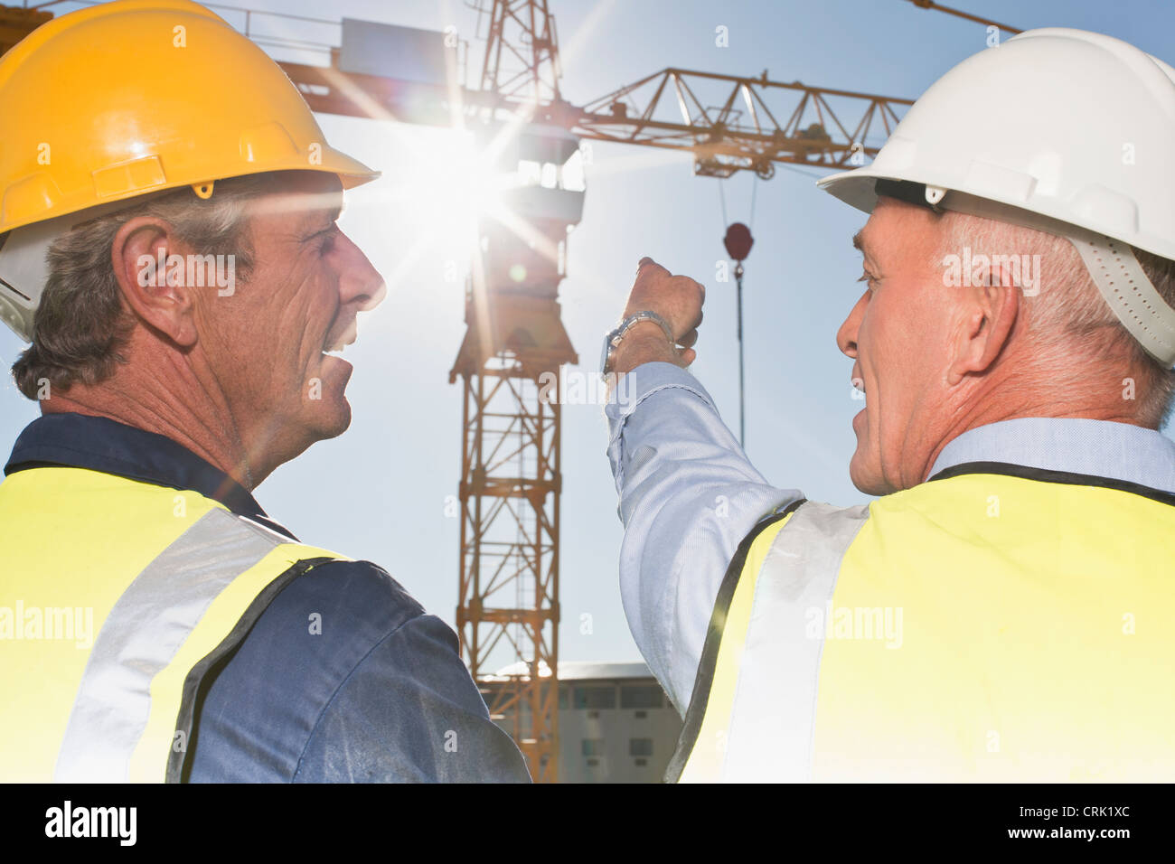 Workers talking on construction site - Stock Image