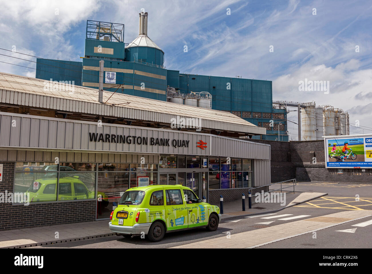 Warrington Bank Quay station with the Unilever factory behind. Stock Photo