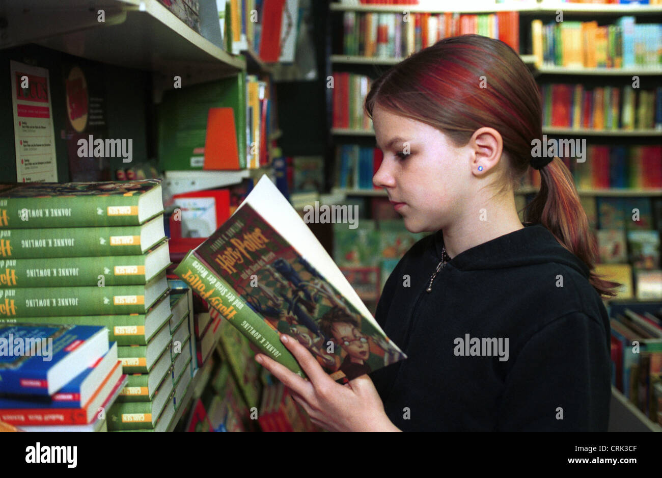 Reading girl in a bookstore Stock Photo