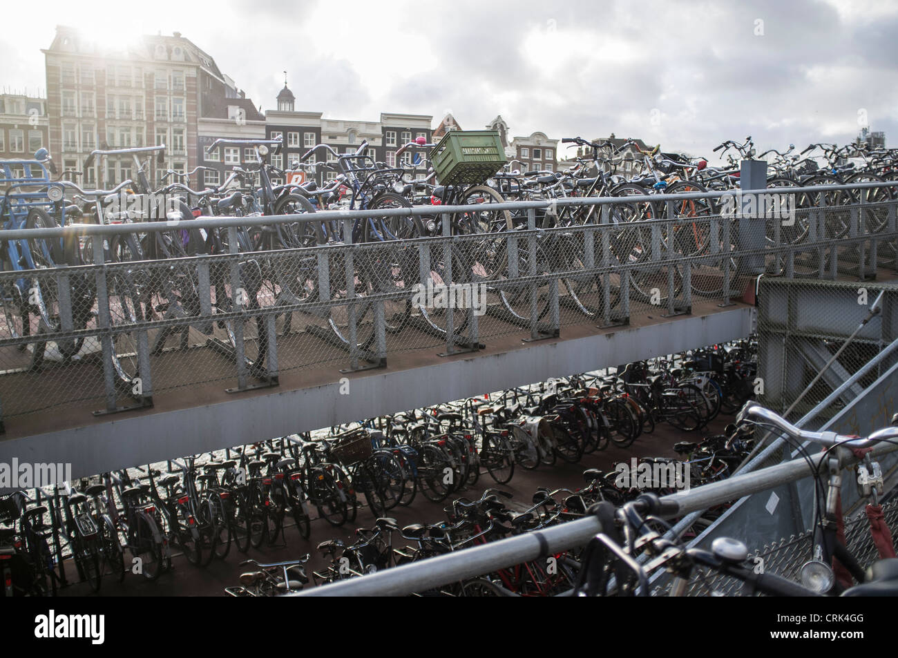 Bicycles parked on city sidewalk - Stock Image