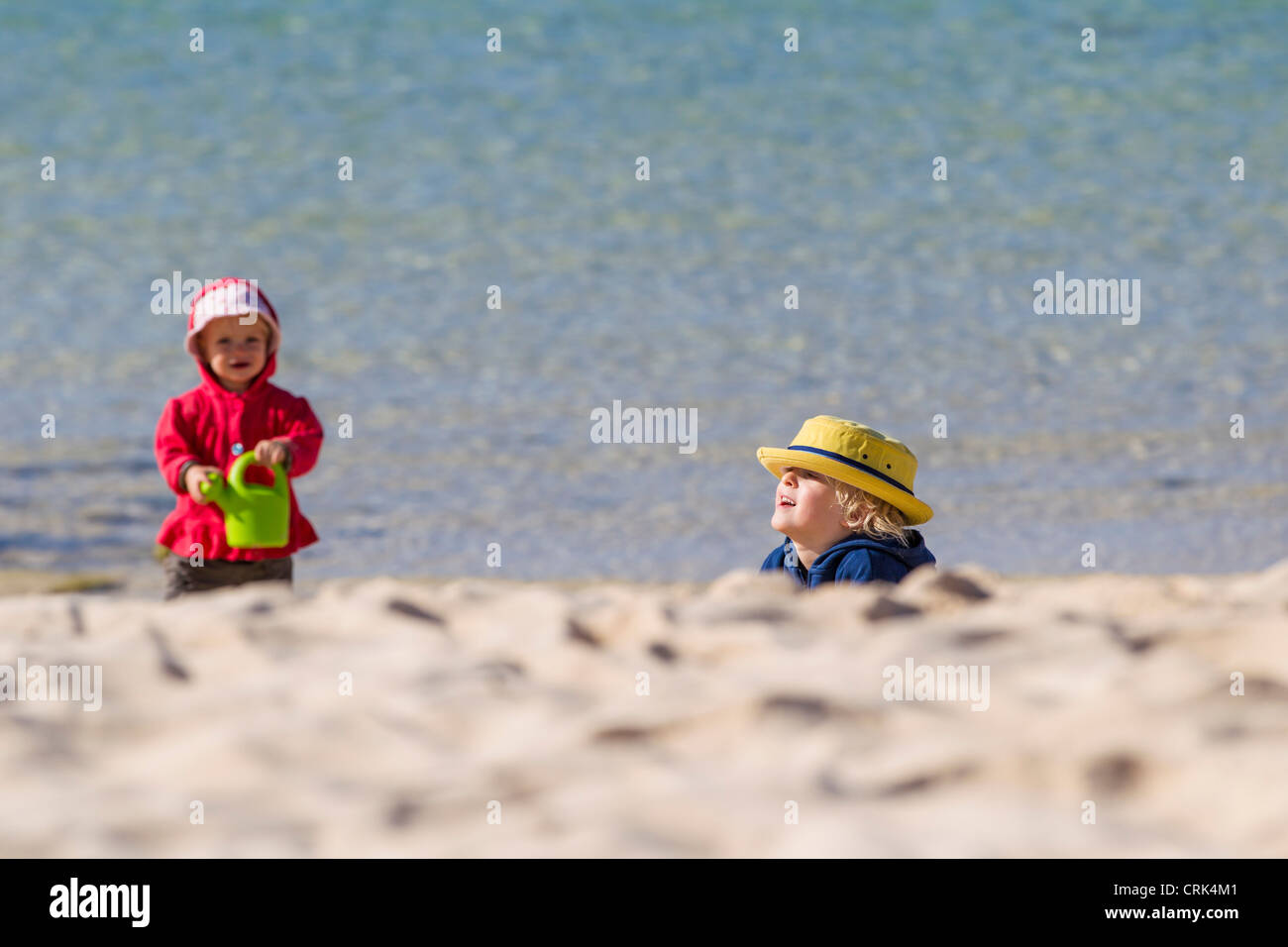 Children playing on sandy beach - Stock Image