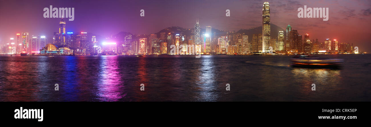 Victoria Harbour and the skyline at night, Hong Kong, China - Stock Image