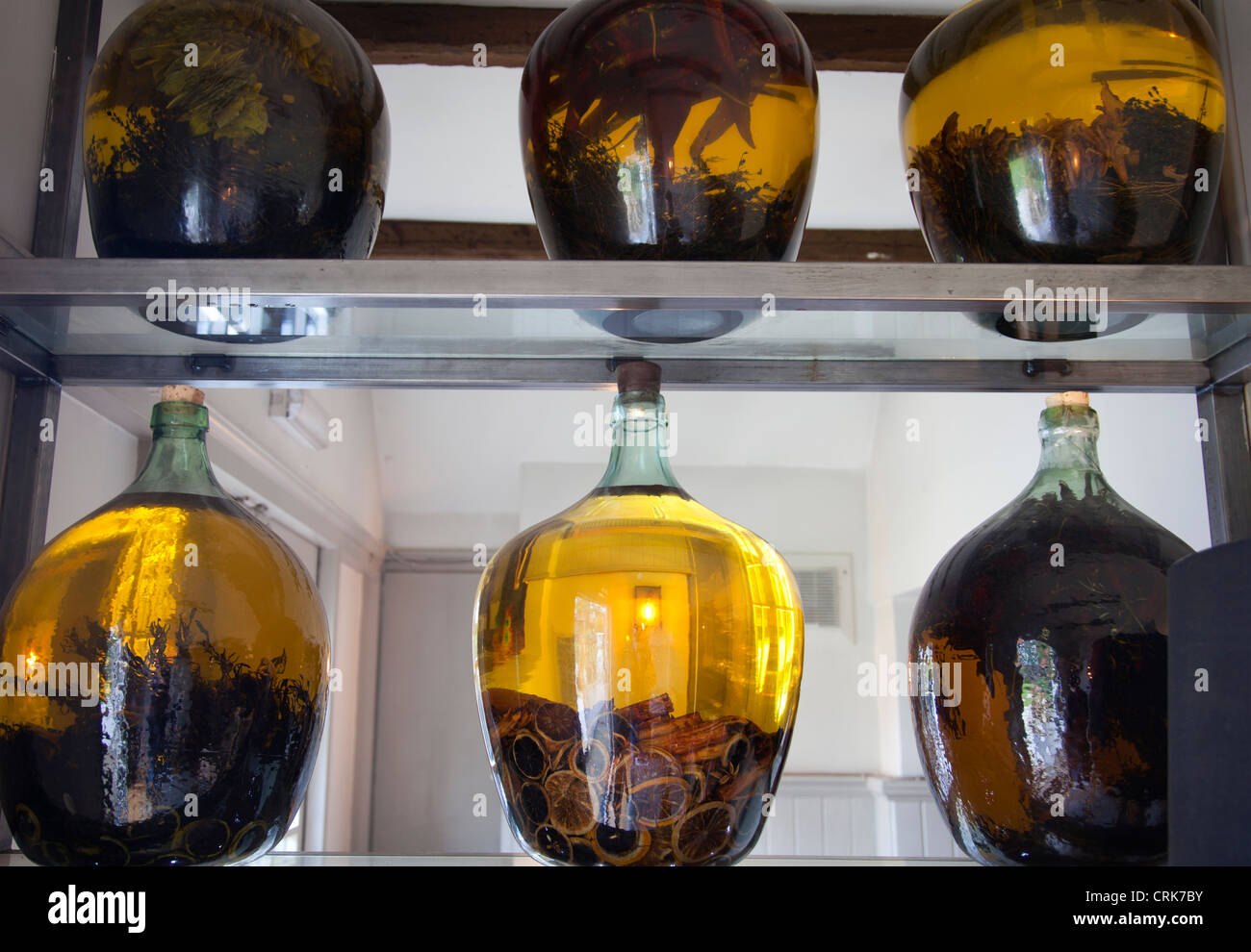 Oil Jars with Spices and Lemon as Restaurant Decoration - Stock Image