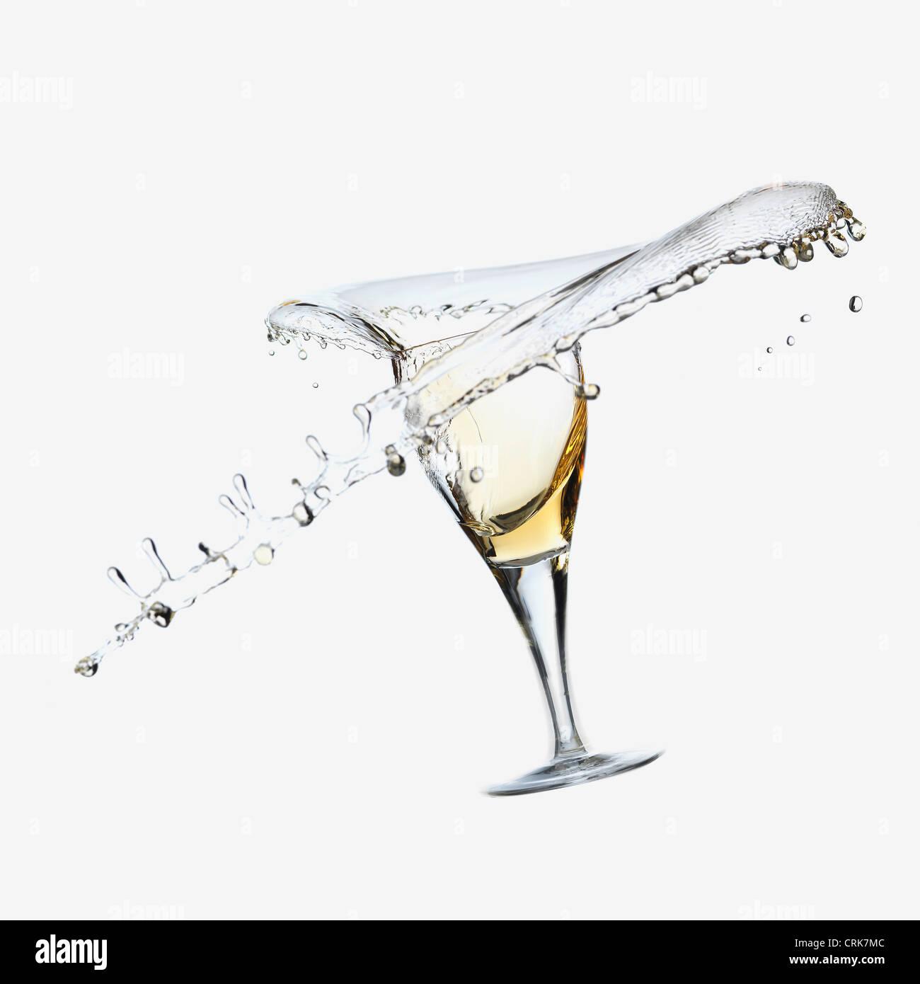 Wine splashing from glass Stock Photo