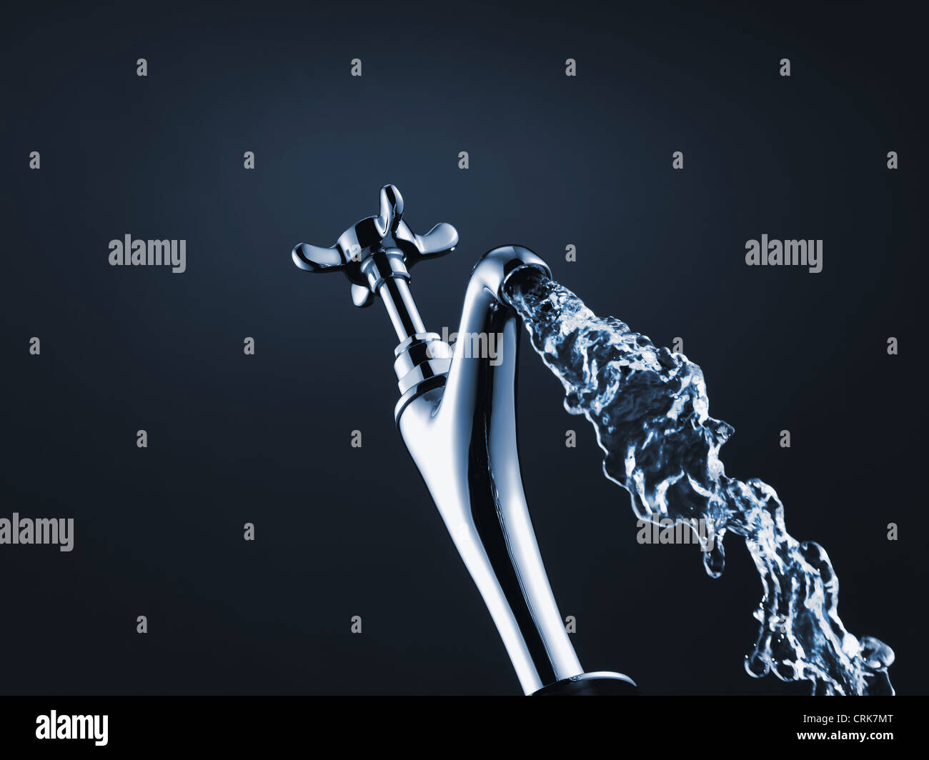 Close up of water pouring from faucet - Stock Image