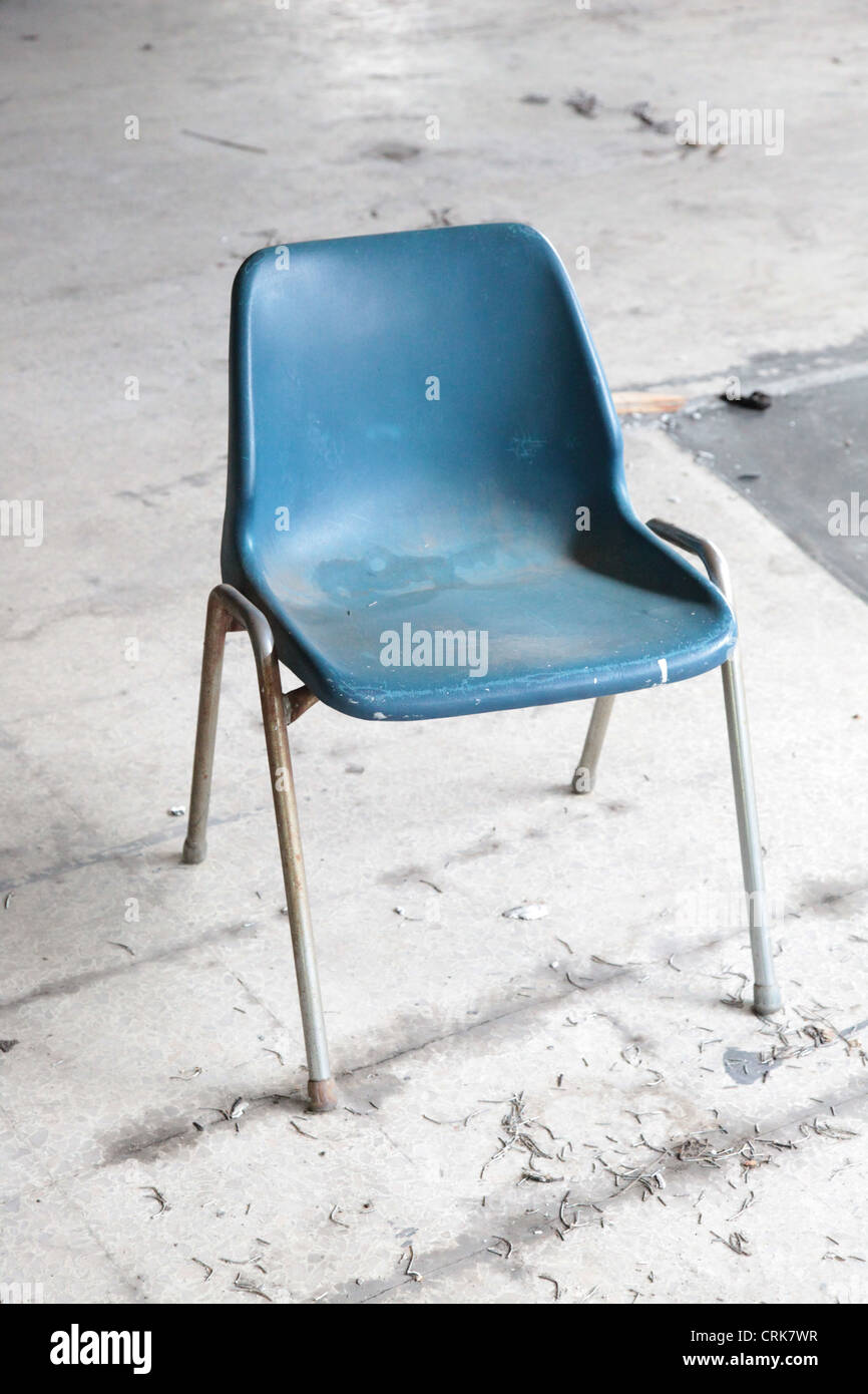 Old office chair Plastic Its Photo Of Blue Plastic Office Chair That Is Old Dirty And Abandoned Like This On The Floor In Factory Alamy Its Photo Of Blue Plastic Office Chair That Is Old Dirty And