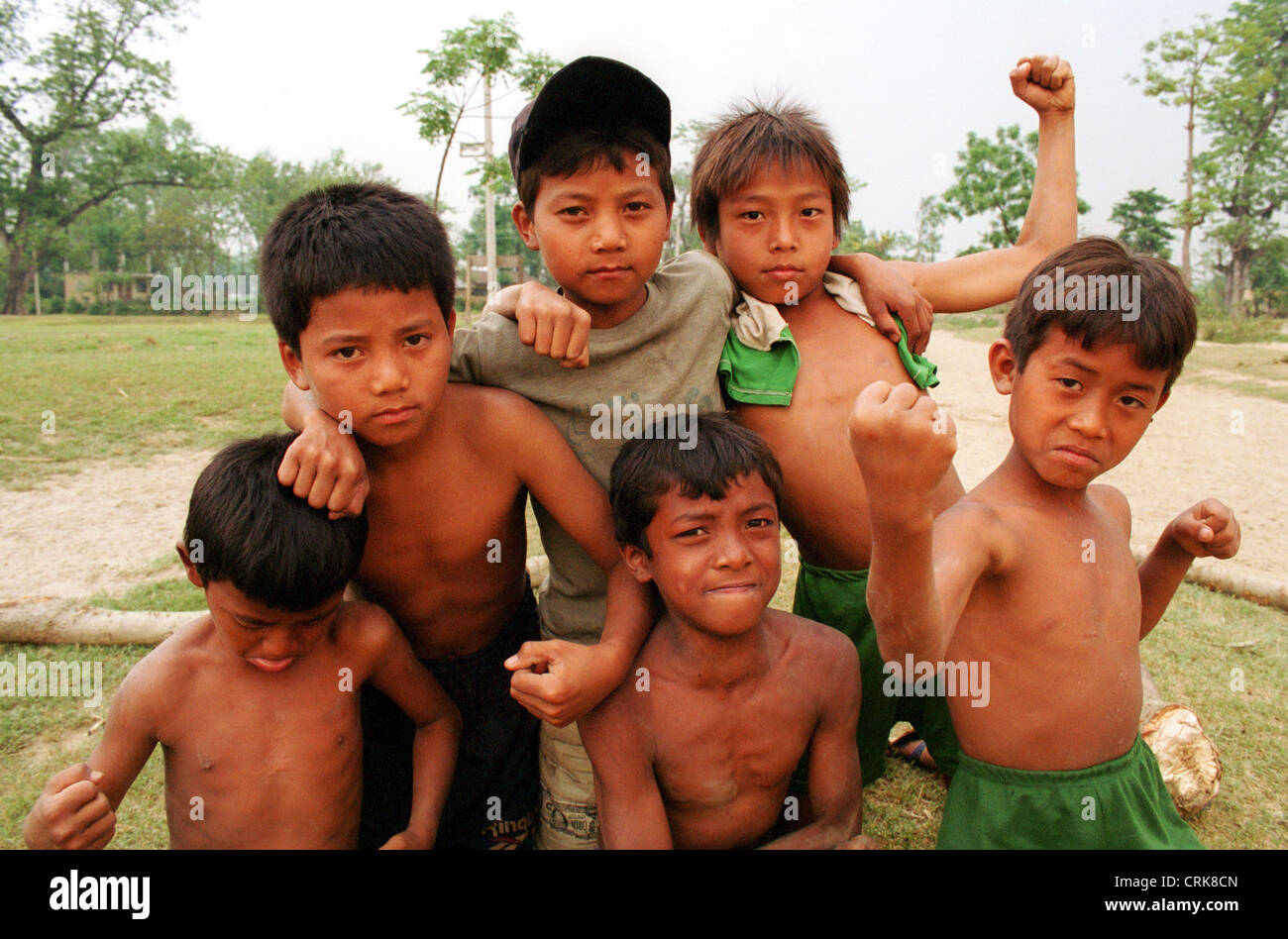 Group of boys posing clench the fists in Nepal - Stock Image