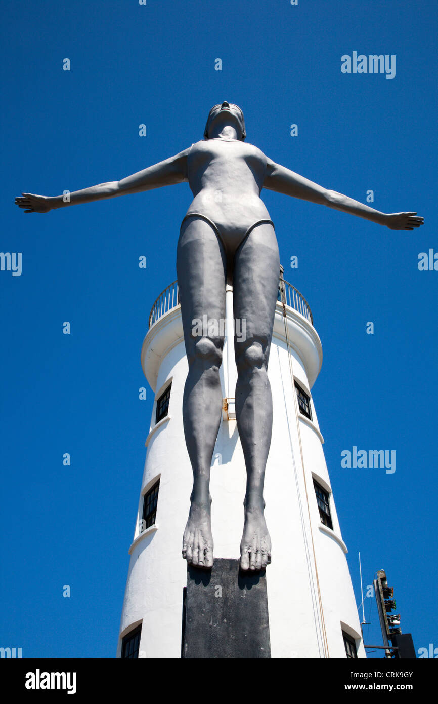 The Diving Belle Sculpture and Lighthouse on Vincents Pier Scarborough North Yorkshire England - Stock Image