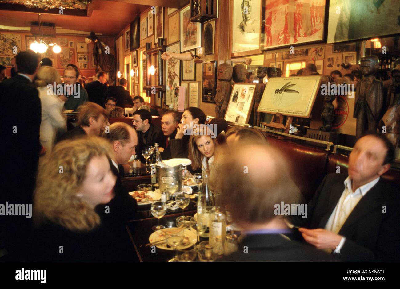 Guests talk at the Paris Bar - Stock Image