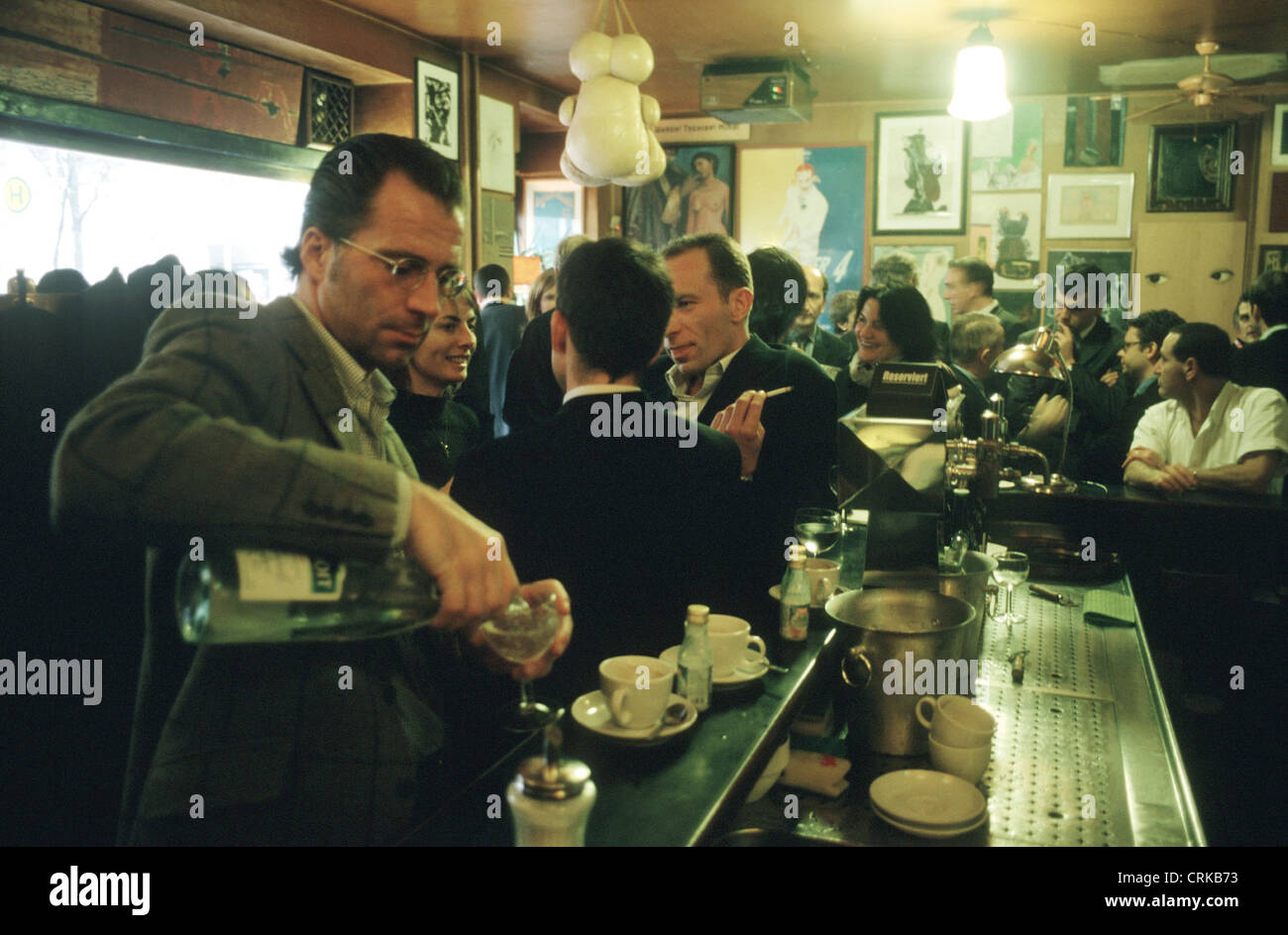 Guests talk at the Paris Bar - Stock Image