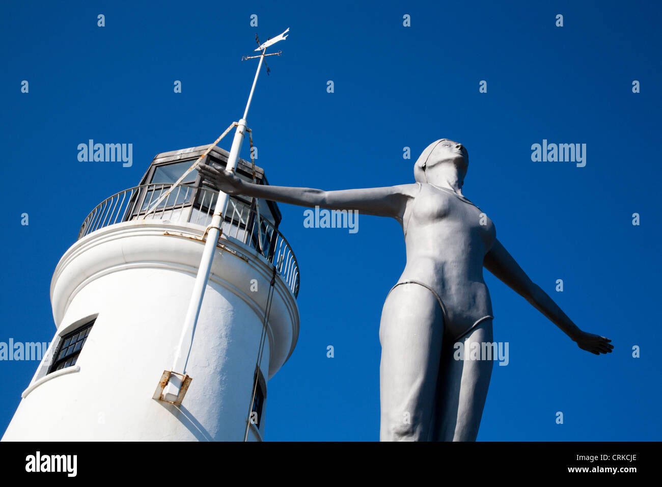 The Diving Belle Sculpture and Lighthouse at Vincents Pier Scarborough North Yorkshire England - Stock Image