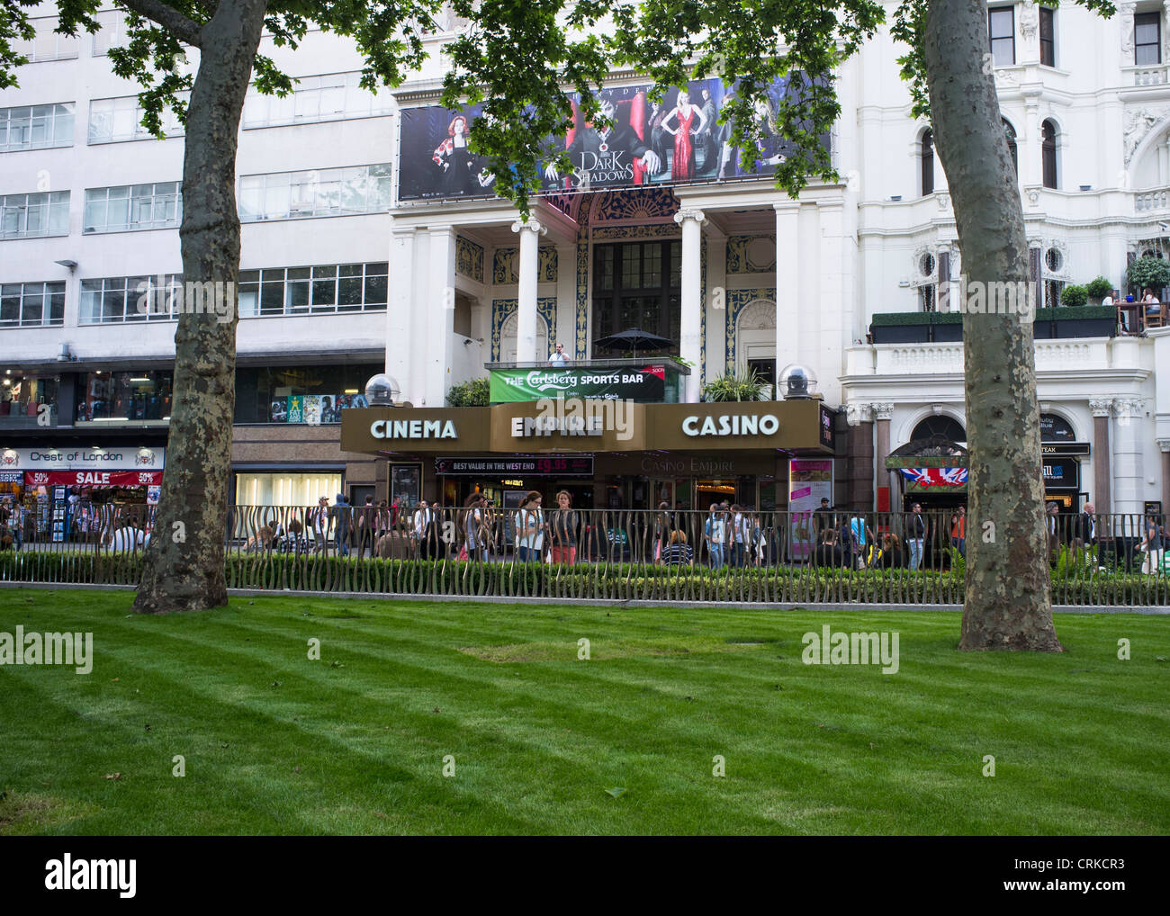 The Empire Cinema from Leicester Square Gardens just after the gardens were refurbished in 2012 - Stock Image