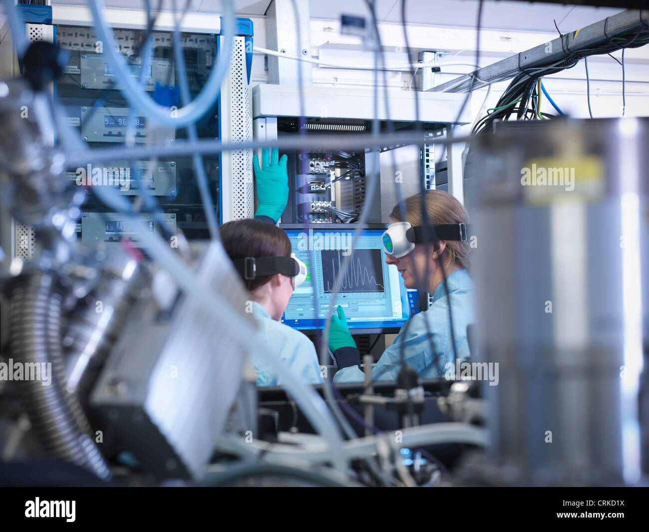 Scientists working at computer in lab Stock Photo