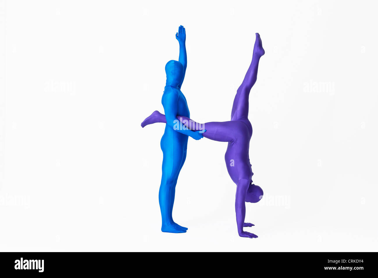 Men in bodysuits making the letter H - Stock Image