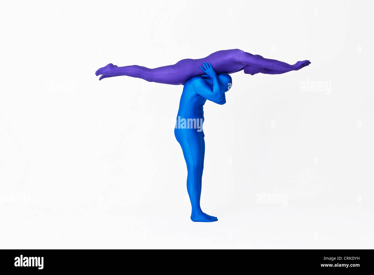 Men in bodysuits making the letter T - Stock Image