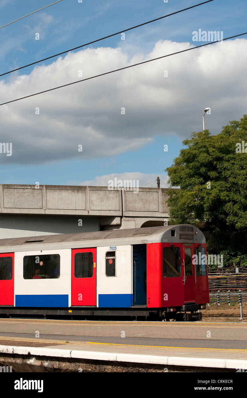 London Underground train waiting at a railway station in London, England. Stock Photo