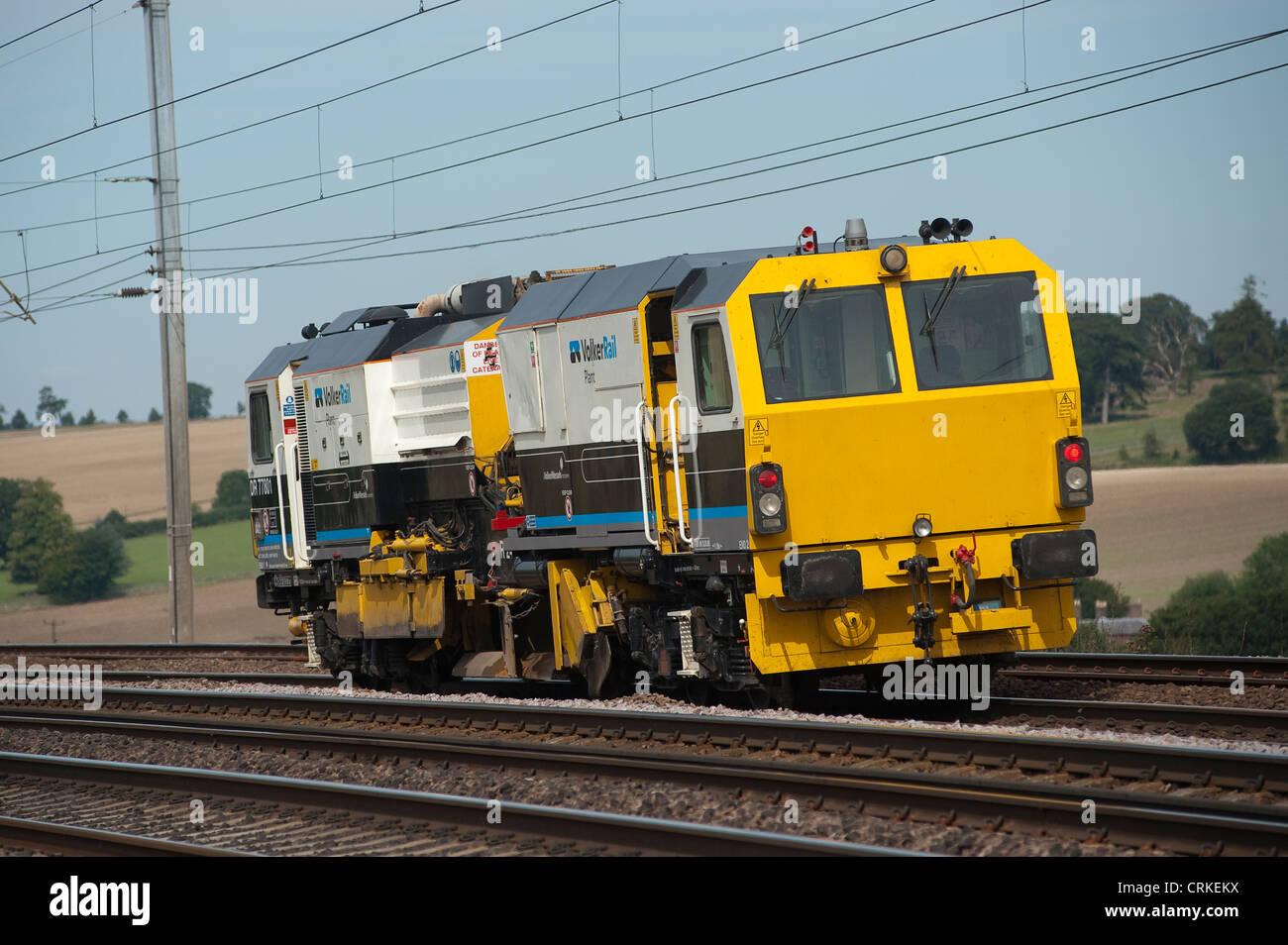 VolkerRail Ballast Regulator maintenance train on the Midland mainline, England. - Stock Image