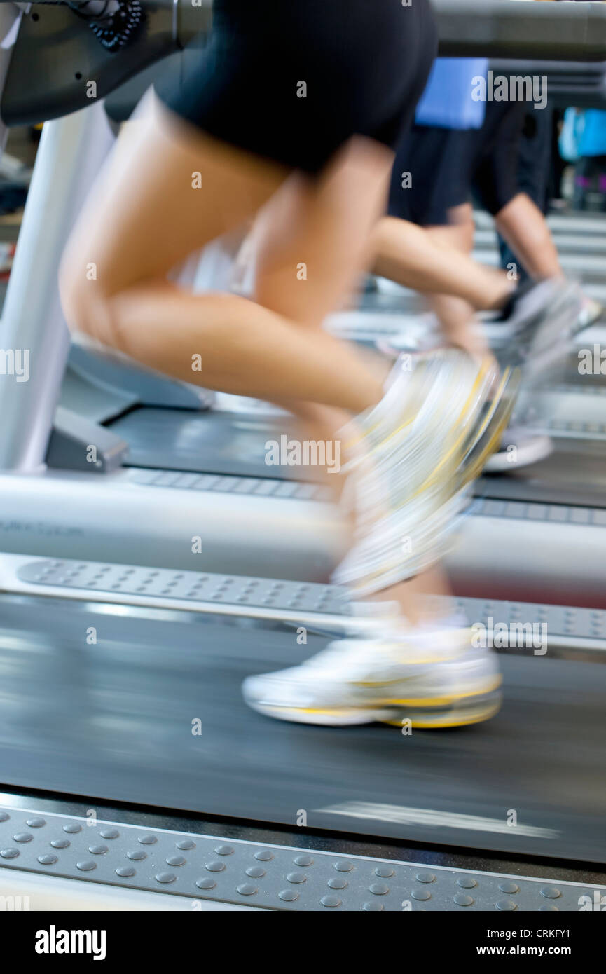 Blurred view of people on treadmills - Stock Image