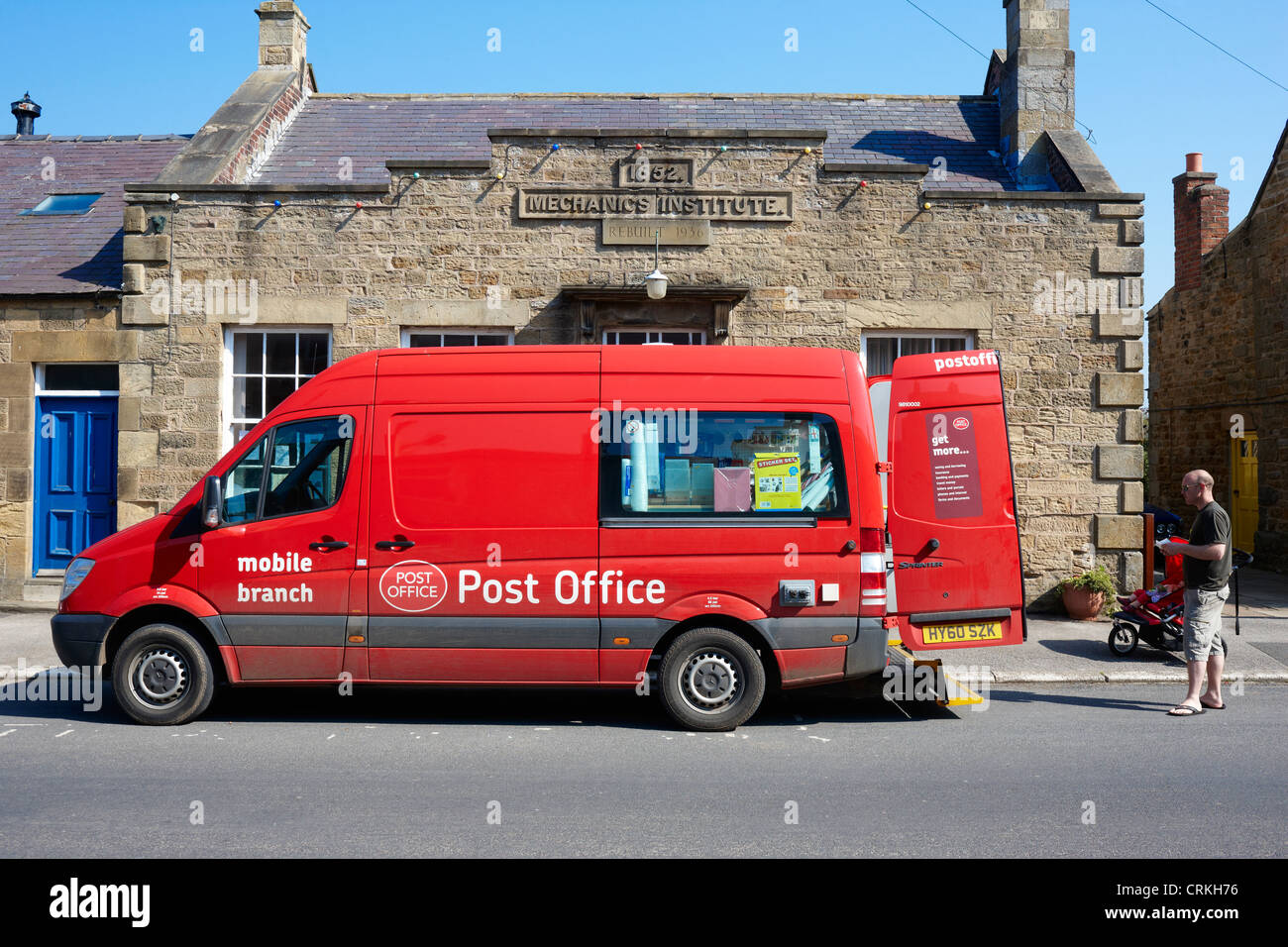 Mobile Post Office van visits the rural village of Kirkby Malzeard in North Yorkshire UK - Stock Image