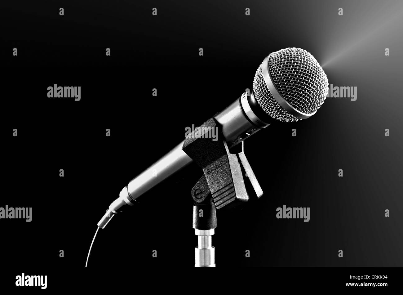 Silvery microphone on black - Stock Image