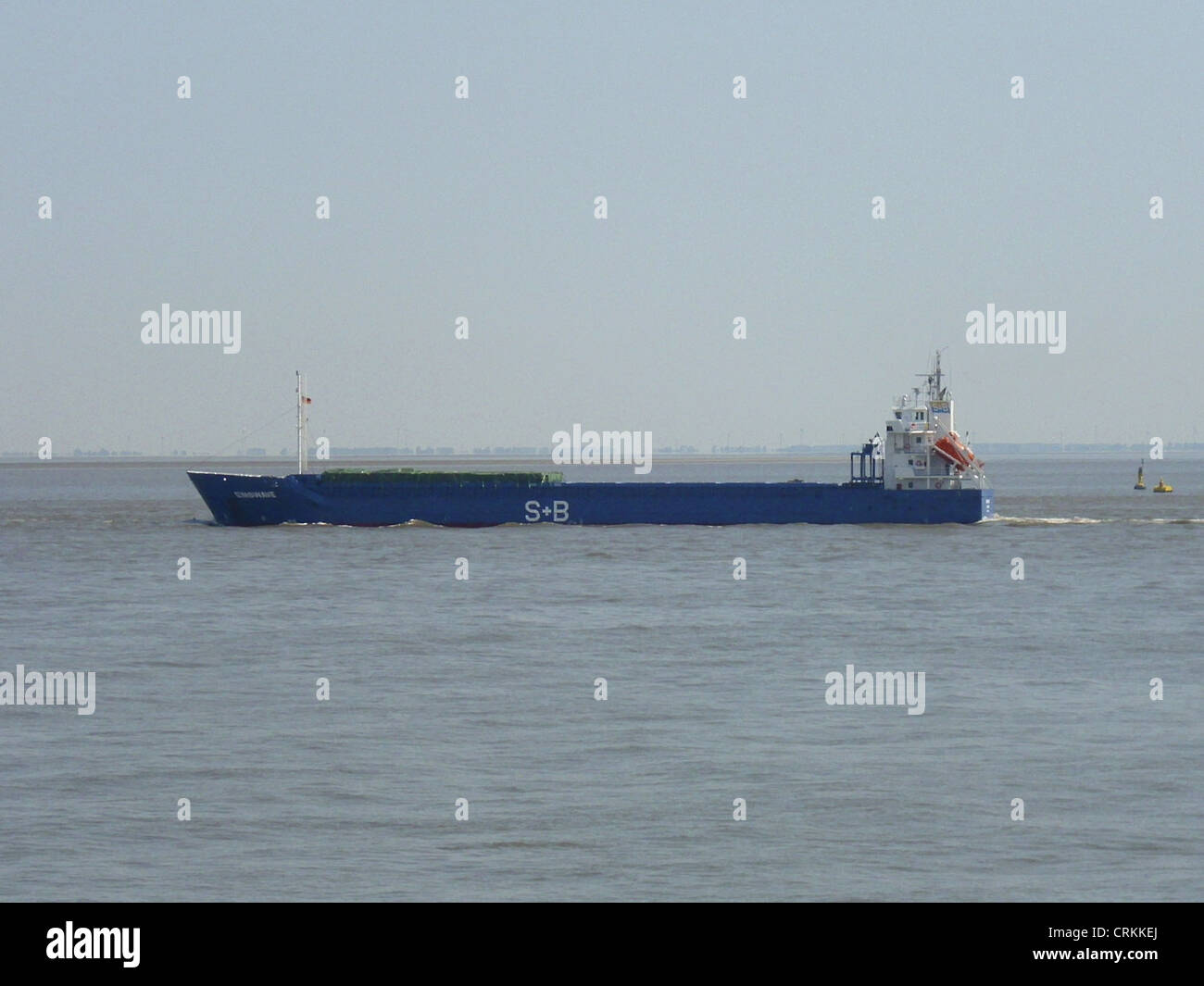 The general cargo ship '''Emswave''' outbound om the Elbe river - Stock Image