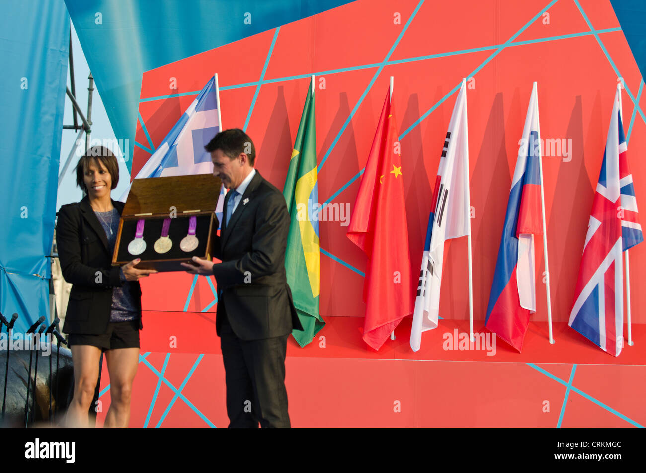 Dame Kelly Holmes and Lord Sebastian Coe holding new Olympic medals ' 1 year to go to'  London 2012 Olympics - Stock Image
