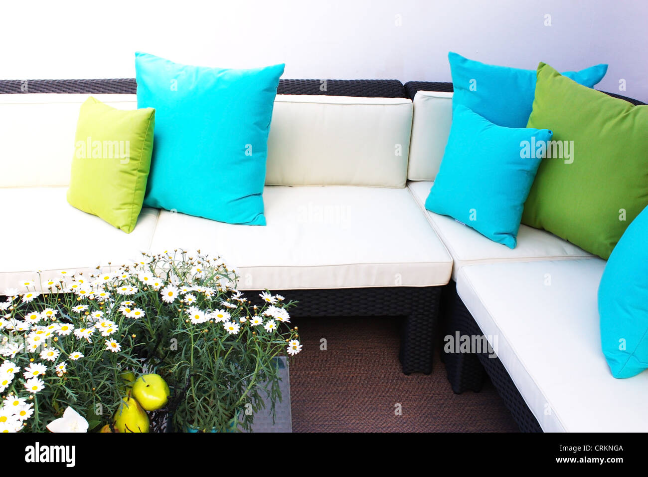Sofa with blue and green pillow cushions Stock Photo