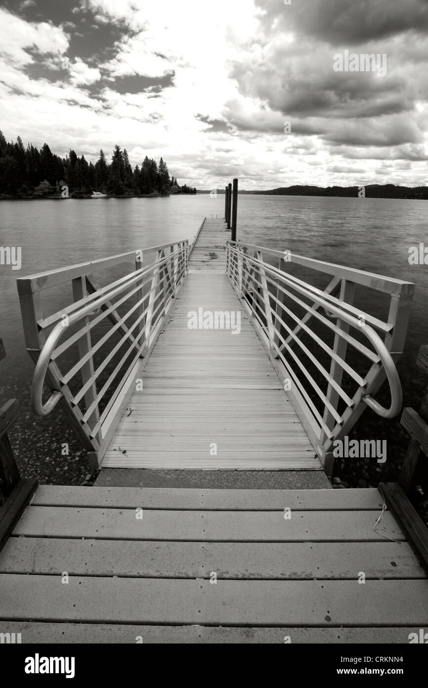 A black and white image of a dock by Coeur d'Alene Lake in north Idaho. - Stock Image