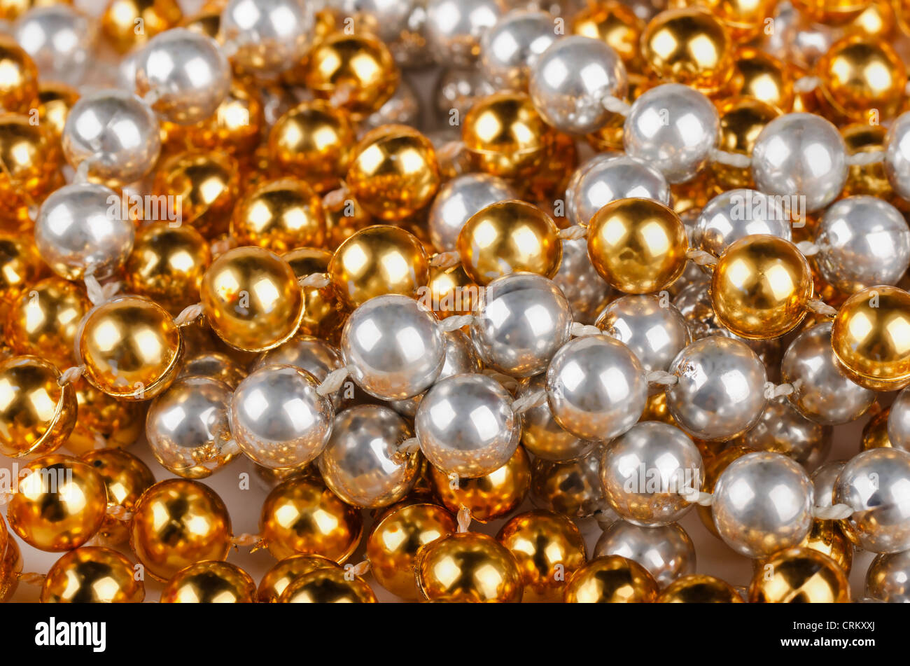 Background of gold and silver christmas beads - Stock Image