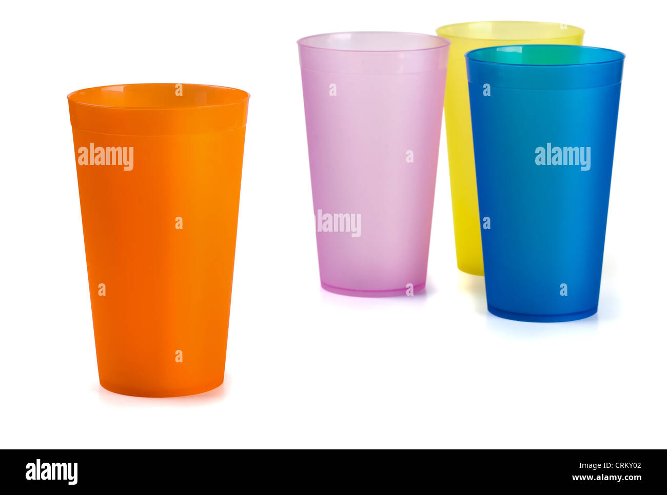 Four colorful plastic cups isolated on white - Stock Image