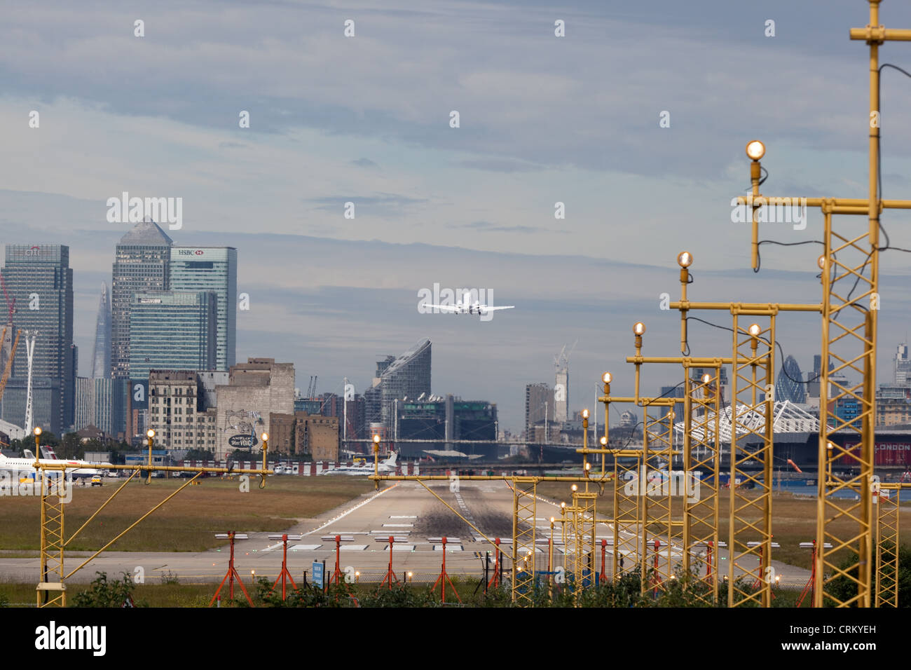 Jet taking off London City Airport - Stock Image