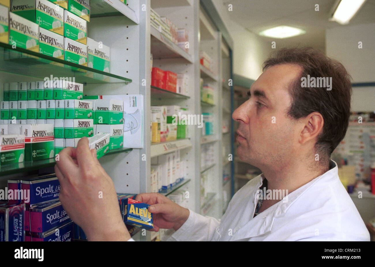 Pharmacist selects from painkillers - Stock Image
