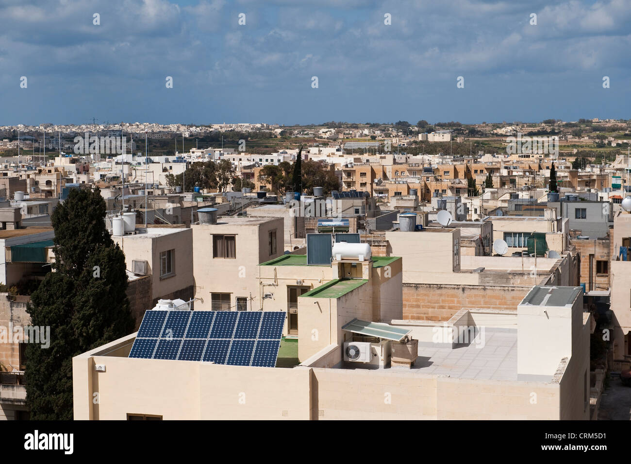 Zejtun, Malta. A rooftop view shows many houses with passive solar water heaters and solar panels - Stock Image