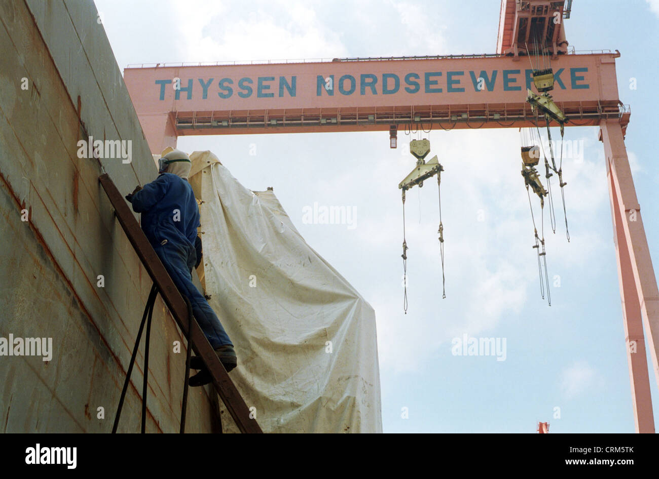 Emden, a worker of the Thyssen Nordseewerke AG edit a hull - Stock Image