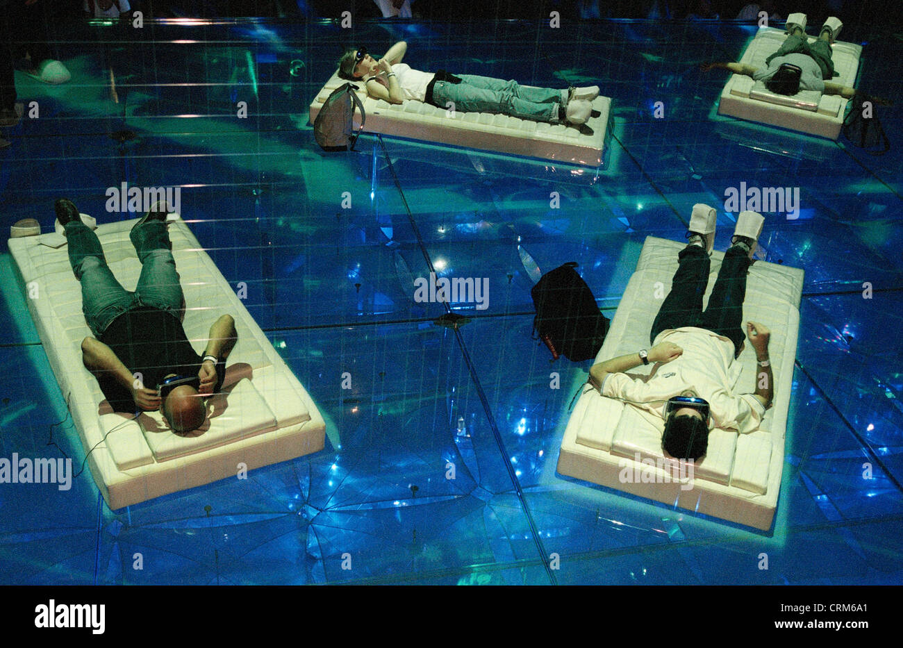 Expo 2002 visitors experience cyberspace lying on mattresses - Stock Image
